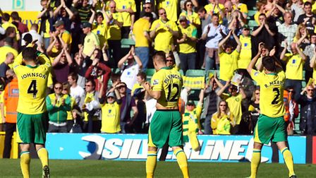Norwich City players and fans celebrate the pressure-releasing win over Reading. Picture: Paul Chest