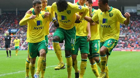 Kei Kamara joins in the celebrations for a goal by Norwich City's Wes Hoolahan at Sunderland last mo