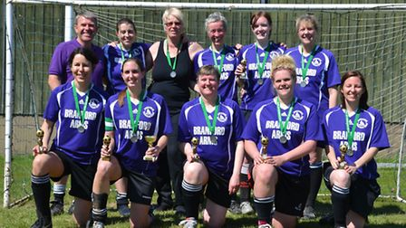 Hellesdon Belles with their League Cup medals and league runners-up trophies.