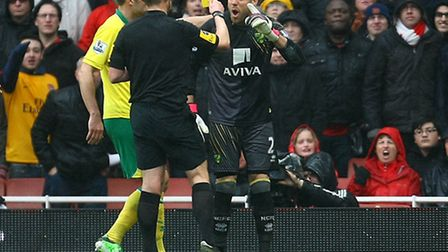 Goalkeeper Mark Bunn is booked for his protests at Arsenal's penalty last weekend. Picture: Paul Che