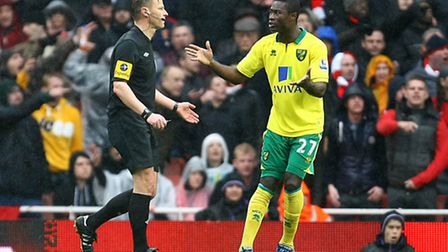 Alex Tettey protests to referee Mike Jones about the penalty award to Arsenal. Picture: Paul Chester