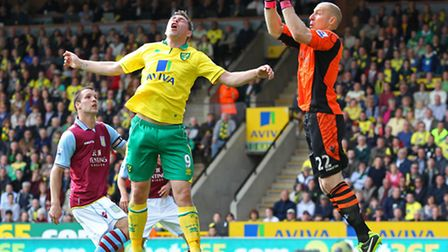 Brad Guzan collects the ball safely ahead of Grant Holt. Picture: Paul Chesterton / Focus Images