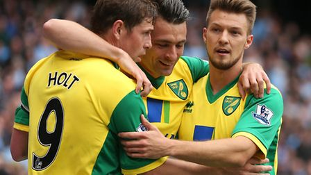 From left Grant Holt, Russell Martin and Anthony Pilkington celebrate during Citys thrilling final d