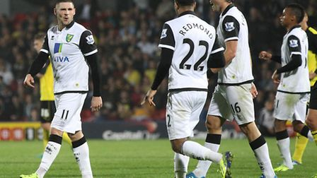Gary Hooper and his new Norwich City team-mates rightly afford themselves a smile at Watford. Pictur