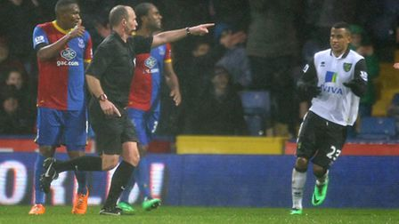 Mike Dean shows off his post-penalty award follow-through at the end of the first half at Selhurst P