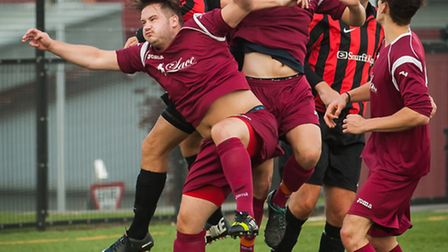 Action from the Sunday League match between Schoolhouse (maroon) and Sprowston Wanderers. Photo: Bil