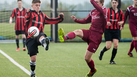 Players battle for possession during the Sunday League match between Schoolhouse and Sprowston Wande
