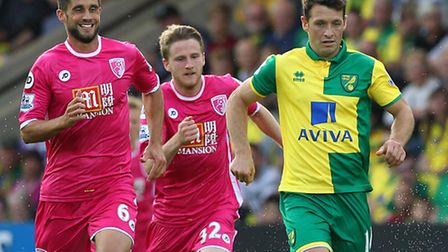 Andrew Surman admires former team mate Wes Hoolahan during Norwich City's victory over Bournemouth.