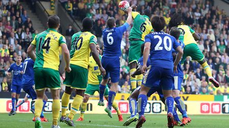 Robert Huth handballs a header by Dieumerci Mbokani but no penalty is given by referee Mark Clattenb
