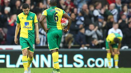 The Norwich City players look dejected after conceding a third goal at Newcastle. Picture: Paul Ches