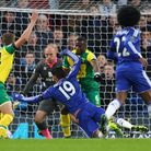 Diego Costa is tackled by Sebastien Bassong at Stamford Bridge. Picture: Paul Chesterton/Focus Image