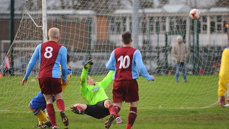 Sunday League. Dussindale Rovers (claret/blue) against Acle Rangers. The Dussindale goalkeeper watch