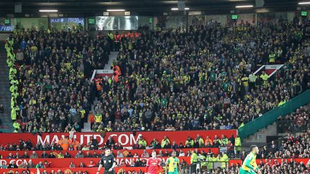 The travelling Norwich City fans during the 2-1 win at Manchester United. Picture: Paul Chesterton/F