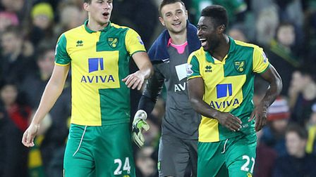 From left Ryan Bennett, Declan Rudd and Alex Tettey celebrate victory over Southampton at Carrow Roa