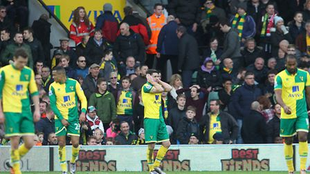 The Norwich City players look devastated after conceding a fifth goal deep in added time. Picture: P