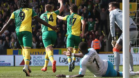 Timm Klose wheels away to celebrate scoring his first Norwich City goal against Newcastle United on