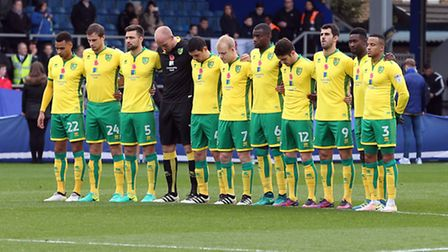 The Norwich City players observe the one minute's silence for Remembrance Day before the QPR fixture