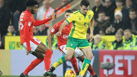 Jonny Howson battles for the ball against Huddersfield Town at Carrow Road. Picture by Paul Chestert