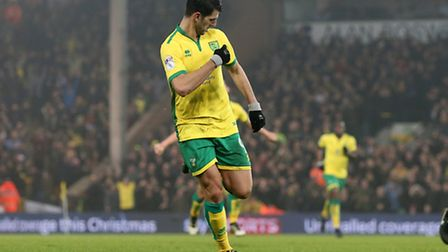 Nelson Oliveira thanks the badge after scoring Norwich City's winner over Aston Villa on Tuesday nig