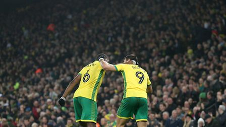 Nelson Oliveira celebrates with Sebastien Bassong after notching his third goal in three games for h