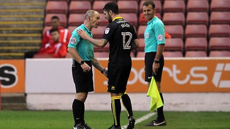 Referee Andy Woolmer has a word with Robbie Brady about his throw-in technique at Oakwell. Picture b