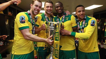 Norwich City captain Russell Martin (second left) and Martin Olsson (right) celebrate gaining promot