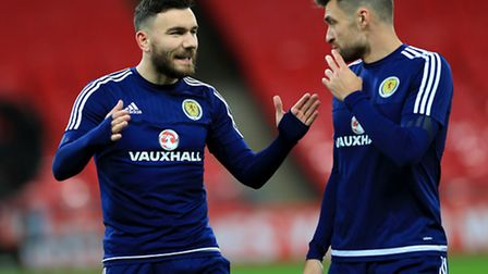 Robert Snodgrass shares a word with City captain Russell Martin while on Scotland duty in the autumn