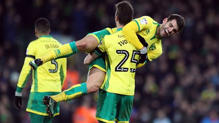 Ivo Pinto helps Nelson Oliveira celebrate completing his hat-trick against Derby at Carrow Road. Pic