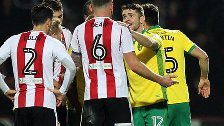 Robbie Brady looks bemused after his is sent off by referee Oliver Langford at Griffin Park. Picture