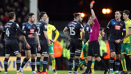 After consulting with his assistant, Derby's Jacob Butterfield is sent off by referee Darren Bond fo