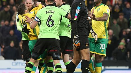 Tempers flare after Carl Ikeme pushes over Wes Hoolahan during City's clash with Wolves at Carrow Ro