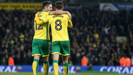 Jonny Howson celebrates scoring Norwich City's third goal against Wolves with the man who got the se