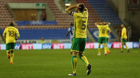 Jonny Howson and Russell Martin come so close to extending Norwich City's first-half lead at Wigan .