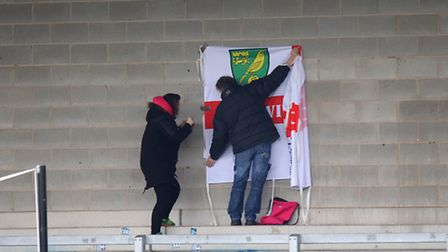 The traveling Norwich City fans get prepared on the terraces at the Pirelli Stadium before kick-off