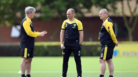 Norwich City manager Alex Neil (centre) chats to first team coach Alan Irvine (left) and assistant F
