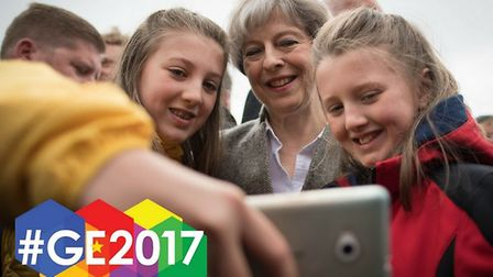 Theresa May poses for a selfie