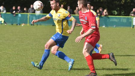 Action from Norwich United's Bank Holiday win over Wroxham. Picture: Sonya Duncan