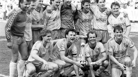 John Deehan, third from the left on the front row, celebrates the Second Division title with his Nor