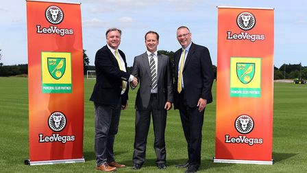 Norwich City chairman Ed Balls, LeoVegas UK head Jon Sinclair and City's managing director Steve Sto