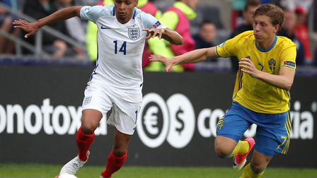 Jacob Murphy, left, and Sweden's Alexander Fransson during the European Under-21 Championship clash