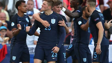 Jacob Murphy, left, celebrates after setting up Alfie Mawson (23) for England's equaliser during the