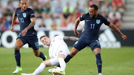 Slovakia's Albert Rusnak battles for the ball with England's Nathan Redmond (right) and Lewis Baker