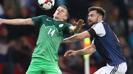 Russell Martin battles for Scotland against Slovenia at Hampden Park earlier this year. Picture: Jan