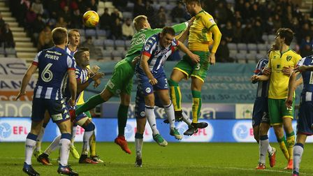 Mitchell Dijks heads home Norwich City's equaliser against Wigan at the DW Stadium. Picture by Paul