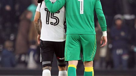 Former Norwich City team-mates Bradley Johnson and John Ruddy share a moment at the final whistle at