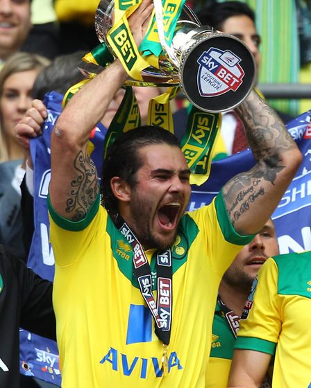 Bradley Johnson lifts the Championship play-offs trophy at Wembley Stadium. Picture: Paul Chesterton