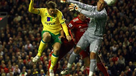 Grant Holt, pictured heading an equaliser at Anfield in a 1-1 draw with Liverpool in the Premier Lea