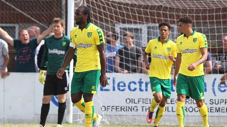 The Norwich players look dejected after conceding against Lowestoft. From left, Michael McGovern, Ca