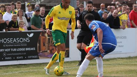Carlton Morris of Norwich and Travis Cole of Lowestoft Town in action during the Pre-season Friendly