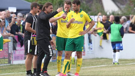 Norwich head coach Daniel Farke give instructions to Yanic Wildschut and Marley Watkins at Lowestoft